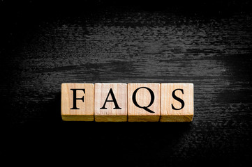 Word FAQS isolated on black background with copy space