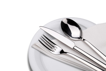 Fork, knife and spoon on a plate with napkin isolated on white.