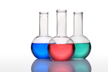 Laboratory glassware with blue,green and red liquid