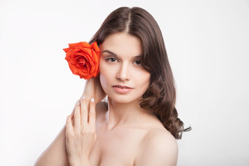 portrait of beautiful brunette woman with red rose