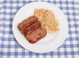 Meatloaf and Brown Rice on White Plate