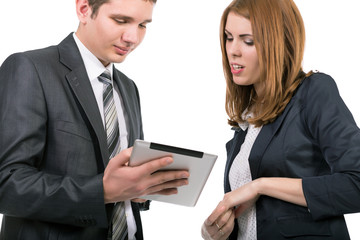 Young officially dressed people having discussion with tablet PC