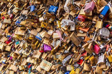 Lots of Padlocks at River Seine, Paris France, symbolizing Love
