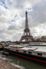Eiffel Tower in Paris France with River Seine and Boats