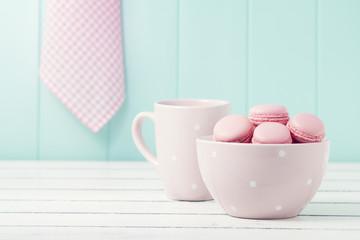 Macarons (macaroons), a bowl and a pink polka dots mug