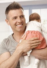 Happy father holding baby girl