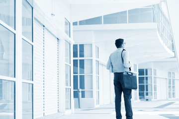 Businessman walking through office building.
