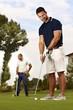 Handsome golfer holing
