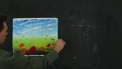 Artist working on a painting.