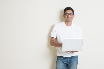 Indian man using computer