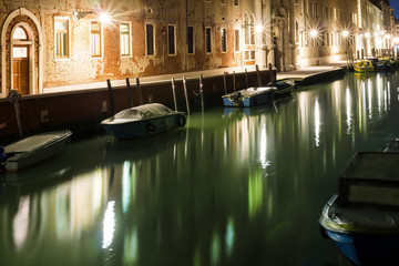 Night scene with boats in channel, Venice