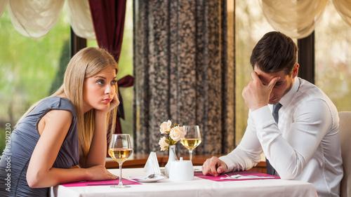 Leinwandbild Motiv Couple is getting bored on first date