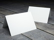 Blank template of folded postcard on a wood floor - 81291441