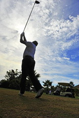 Playing golf, Spain