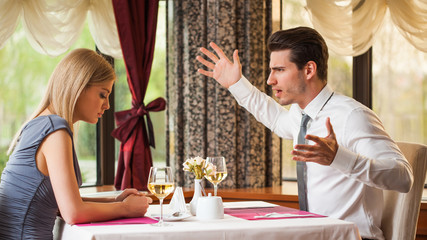 Young couple is arguing at restaurant