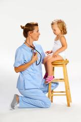 Pediatrician examining a baby girl