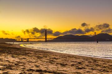 Sunset over Golden Gate bridge in San Francisco, California