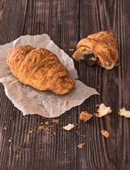 croissant for breakfast on a dark wooden table