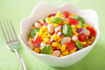 healthy corn salad with tomato onion white bean basil