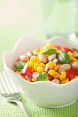 healthy corn salad with tomato onion white bean basil