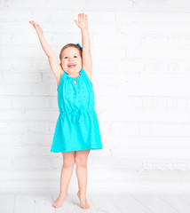 happy little girl raised her hands up and measure your height