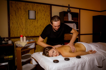 masseur doing massage beautiful girl