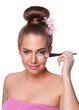 Beauty young woman brushing concealer under eyes isolated on whi