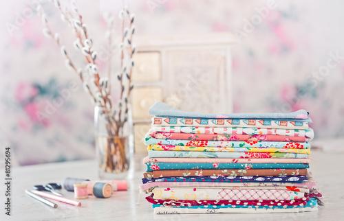 Leinwandbild Motiv Fabric Pile of colorful folded textile with sew items