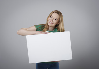 Blonde girl with empty whiteboard