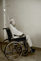Old man sitting in a wheelchair