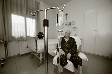 Elderly man in a hospital room