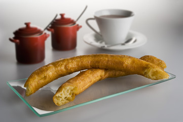 Spanish typical fried porras with a cup of hot chocolat