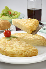Potato omelette with salad, bread and glass of wine