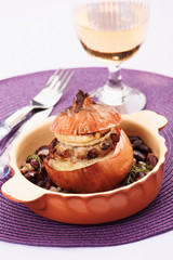 Baked onion stuffed with meat