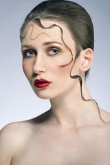 beautiful girl with creative hairdo
