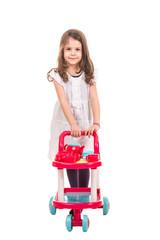 Little girl pushing trolley pram