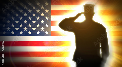Soldier salutes the American flag in the background. - 81299800