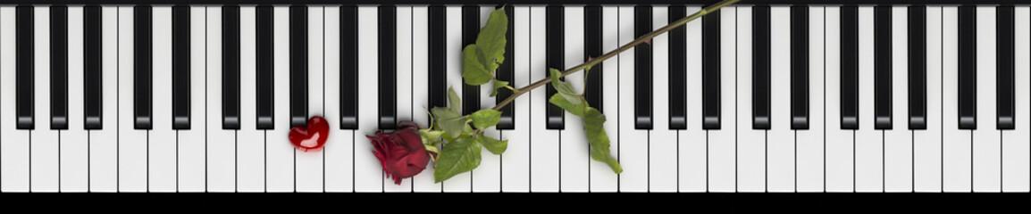 Rote Rose und Herz auf Klaviertastatur Love Songs