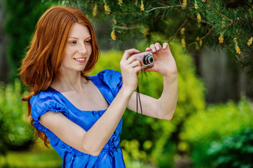 red-haired smiling young woman photographed