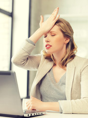 businesswoman holding her head with hand