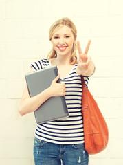 smiling teenage girl with laptop