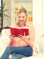 happy and smiling woman with book