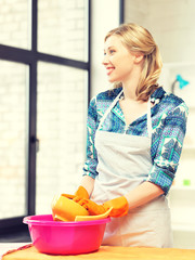 housewife washing dish at the kitchen