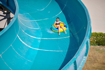 Beautiful girl riding a water slide