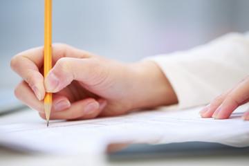 Female hand writing, close up