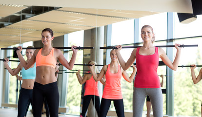group of women with bars in gym