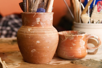 Handmade old clay pots with pencils