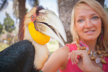 girl holding on a hand beautiful toucan