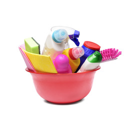 Red bowl with detergent bottles and chemical cleaning supplies