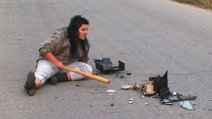 Crazy Woman Talking to Broken TV-set At Driveway
